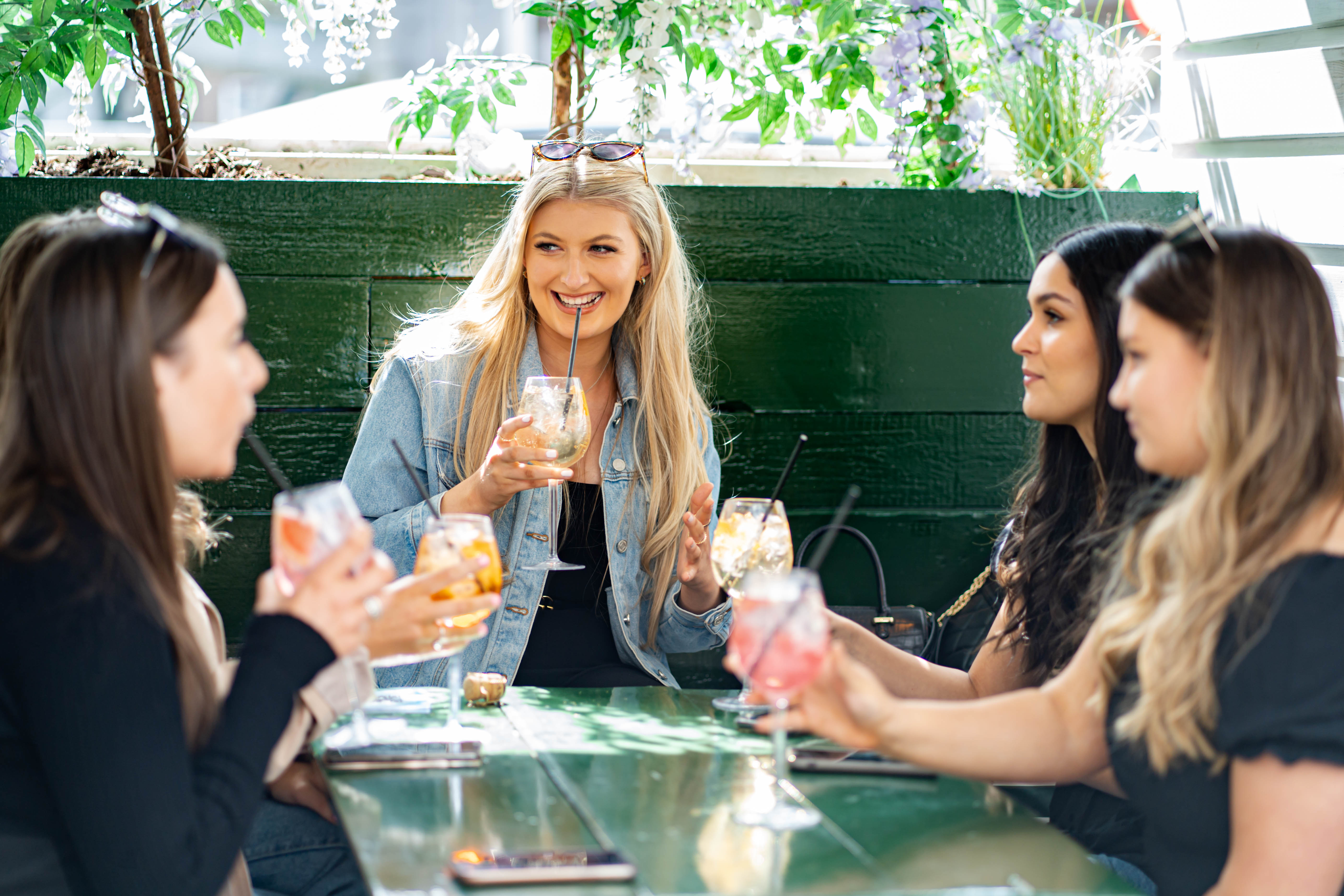 Group of women have a drink at Paddington Central Pergola