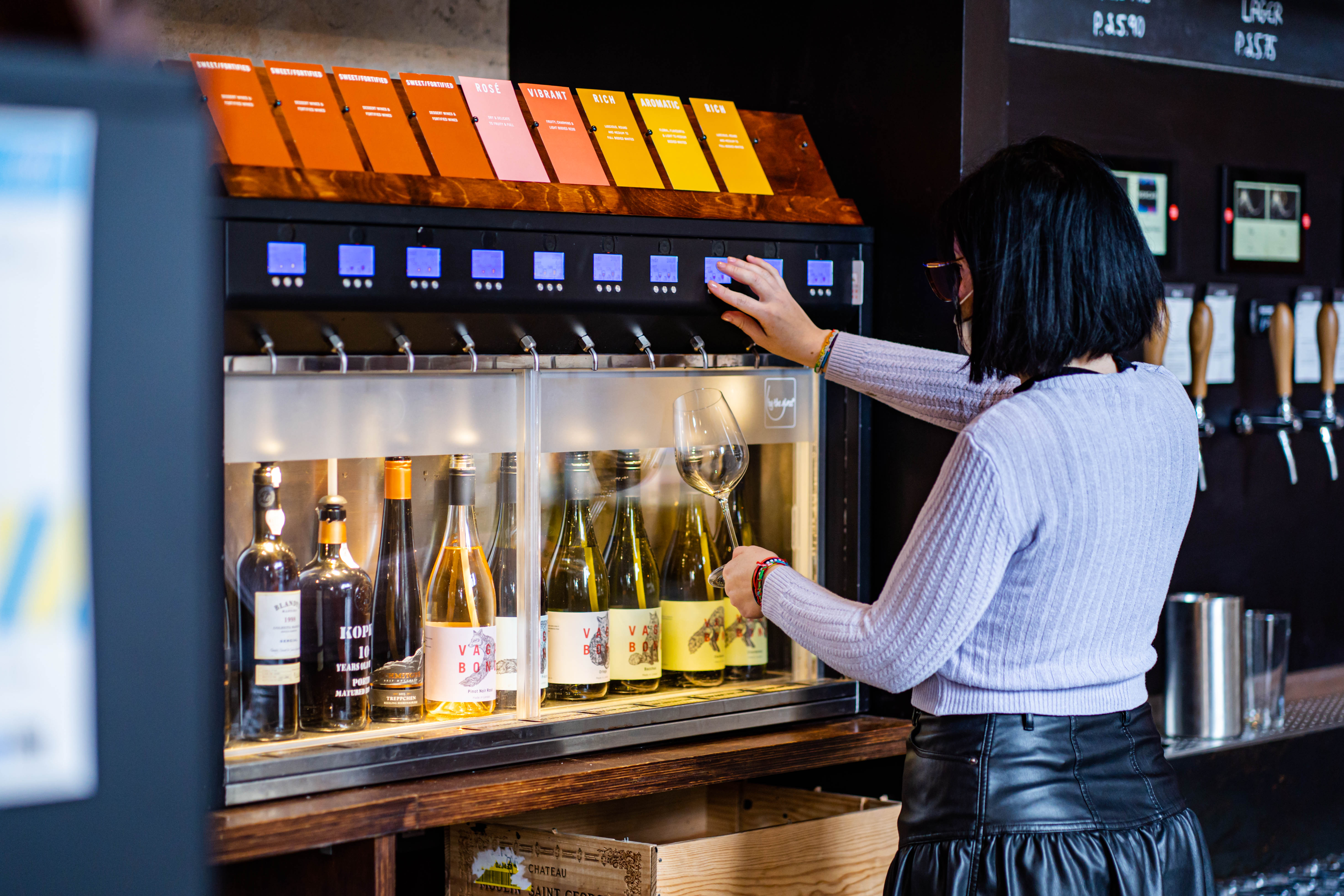 Woman pouring wine at Vagabond